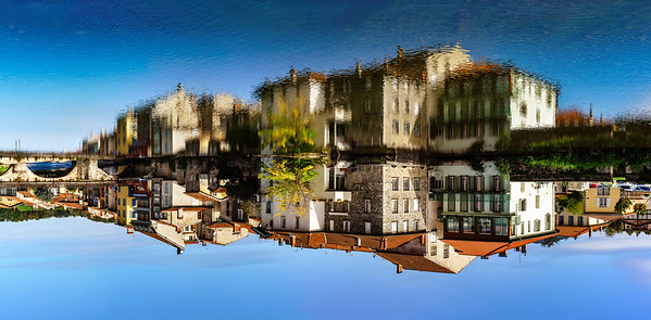 Saint-Girons cityscape panoramic view with reflection in the river water
