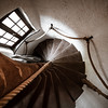 An ancient spiral staircase in a rich medieval house.