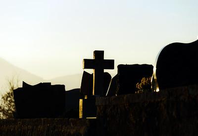Christian cross silhouette on abbey  cemetary