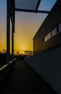New modern building on yellow sunset background