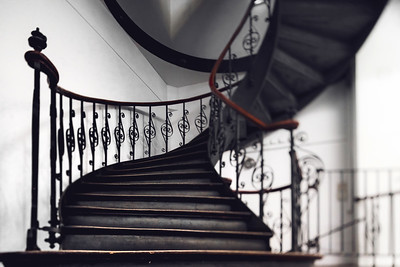Antique vintage rounded staircase in old house, Strasbourg, France