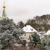Orthodox russian church in Strasbourg, city roofs after snowfall