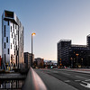 New modern buildings in Strasbourg. Sunset sunlight, lights have already turned on, evening city.