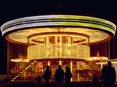 Night Strasbourg. Highlighted carousel on the square Gutenberg
