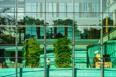 Comfortable office building view through the glass wall
