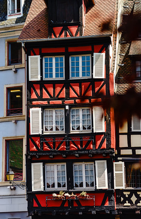 Old beautiful windows in historical center of Colmar, alsacien style
