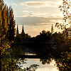 Autumn colors. Plane trees and poplars of rusty and orange colors on the streets and canals of Strasbourg.