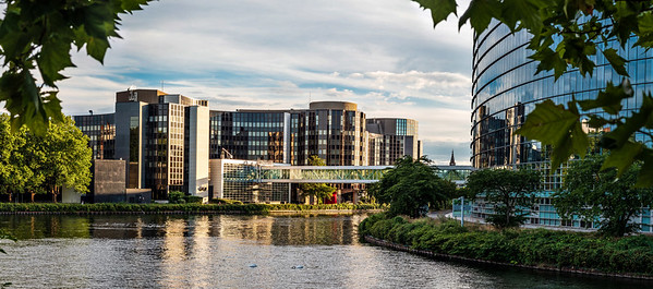 Panoramic view of the European Parliament in Strasbourg with reflection in the river Ill