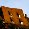 Red tile roofs of old buildings in historical center of Strasbourg