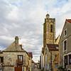 Catholic church in Noyers, Burgundy, France, street view