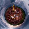 Panoramic little-planet view of village Dambach-la-ville in Alsace. Night view, highlighted houses.