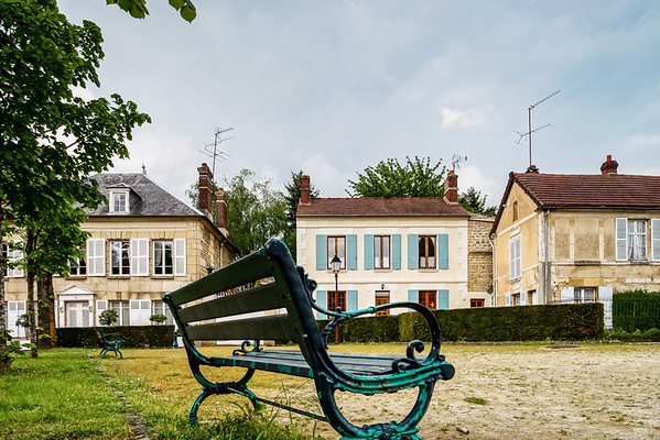 Classic french bench on the street of a little village