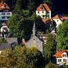 Panoramic view of the Ovald village in Alsace. Sunset, aerial photo from a drone. The idyll and tranquility of a village lost in the mountains.