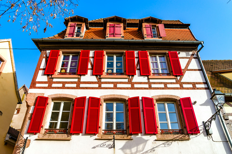Old but beautiful alsacien windows on the sun