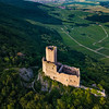 Old medieval fortress Ortenbourg aerial view from drone, sunset time, Vosges mountains, Alsace, France