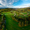A drone rises above a multi-colored valley in the Vosges. Panoramic view.