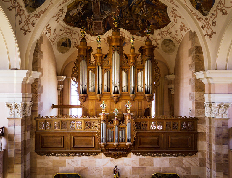 Beautiful music pipe organ in baroque catholic church in Ebersmunster, Alsace, France. Aerial drone view inside the church.