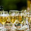 Filling glasses by champagne, outdoor party