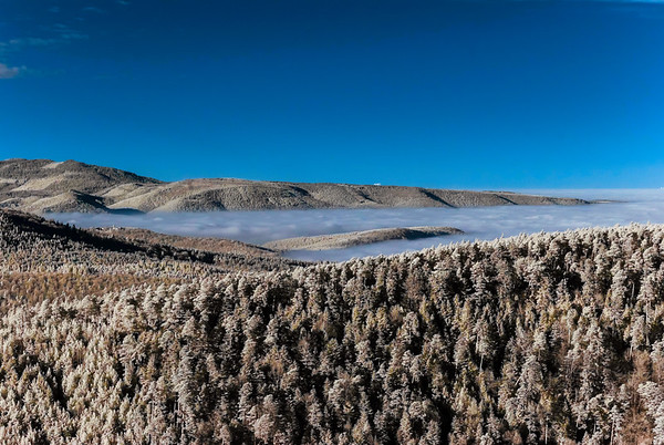 Fantastic aerial infrared view of mountain landscape with sea of fog