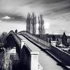 Pedestrian bridge across the river in Auxerre, black and white