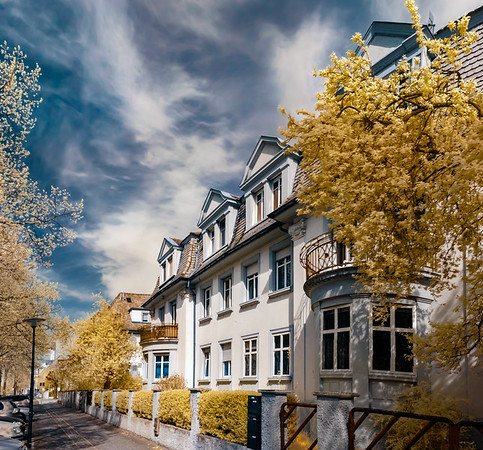 Beautiful calm street  in Strasbourg, infrared view, blooming springtime in contrast colors