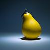 Yellow pumpkin like pear in the dark