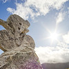 Stoned sculpture of cyclist on blue sky background. Tour de France trace, top point in Spain