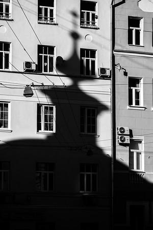 Orthodox church shadow on city house