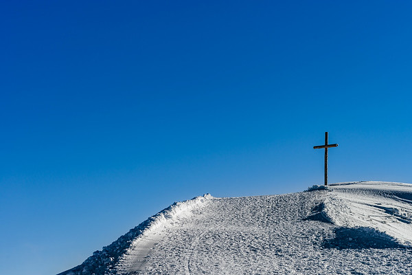 Summit of the rock with big wooden cross