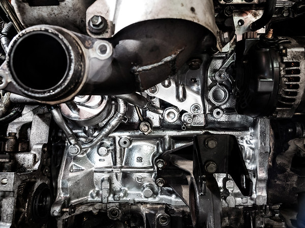 Repair the engine. Tools, oil, nozzles, cylinder block, painting, cleaning, diesel internal combustion engine for a car.
