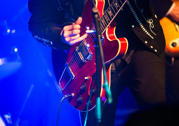 Colorful highlighted guitar on rock concert
