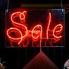 Red neon word Sale in shop window