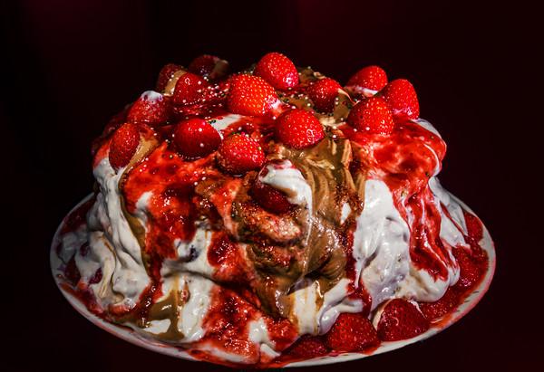 Homemade strawberry cake isolated on dark background