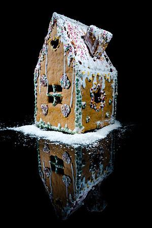 Handmade gingerbread sweet house on black background