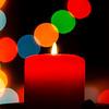 Birning candle on bokeh new year background