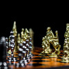 Miniature steel chess figures on chess-board, black against white