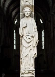 Man of a God. Entrance of the XIII century church. France.
