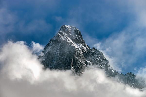 Clouds around the peak of beautiful rock