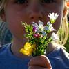 Cute little girl with beautiful field flowers