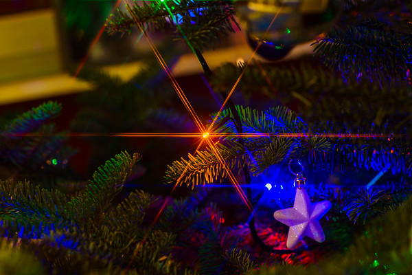 Decorated christmas tree closeup with sparkles, colorful picture