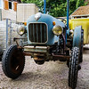 Funny vintage tractor on the farm, countryside