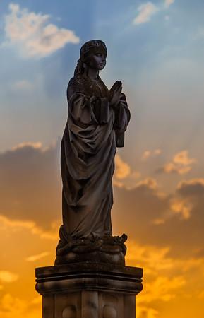 Beautiful sculpture on sunset background