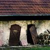 Old abondoned barn with broken doors