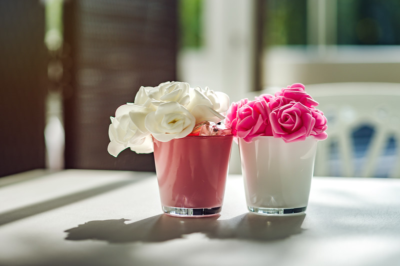 Decoration of cafe table with flowers in soft colors