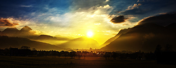Colorful sunset in Schwyz. Switzerland. Wide-angle HD-quality panoramic view.