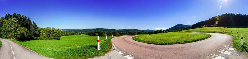 Spiral mountain road panoramic view
