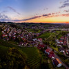 Wide hires panoramic landscape view of green valley in Schwartzwald at sunset.