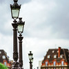 Line of street lamps in Paris, romantic city.