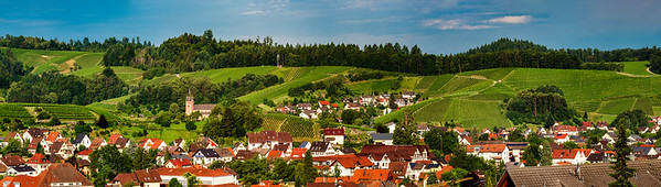Wide hires panoramic landscape view of green valley in Schwartzwald.