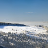 Aerial winter mountains panoramic view. Picturesque and gorgeous wintry scene. Alsace, France. Ski resort.